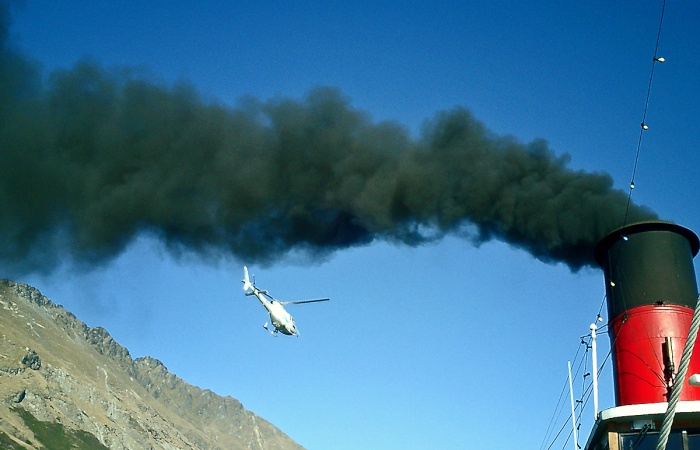 black smoke belches from engine stack of  TSS Earnslaw