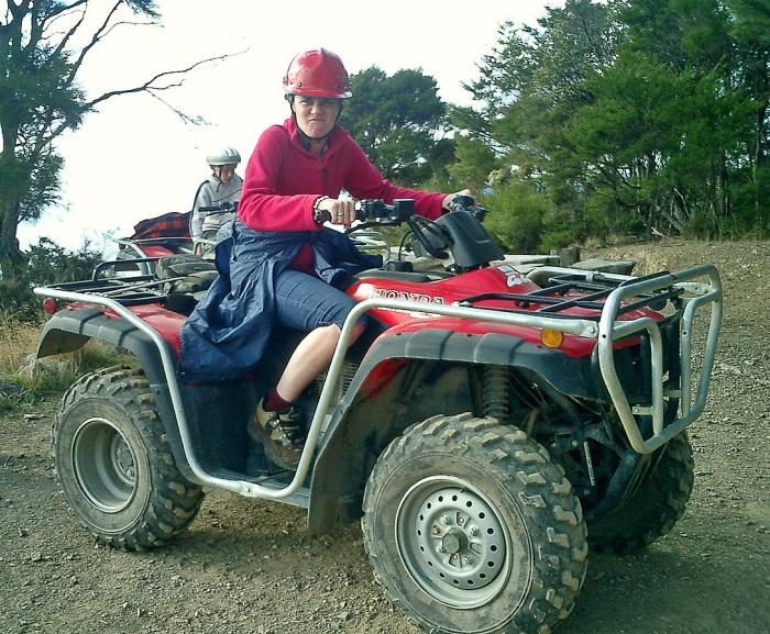 Girl on quadbike above Nelson New Zealand