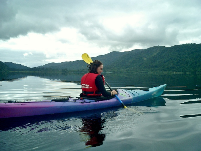 Girl with dreads   on Lake Mapourika New Zealand with Fergal's Kayaks - Oj