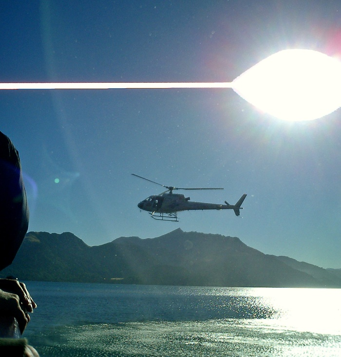helicopter film crew come alongside to shoot promo for TSS Earnslaw 2003