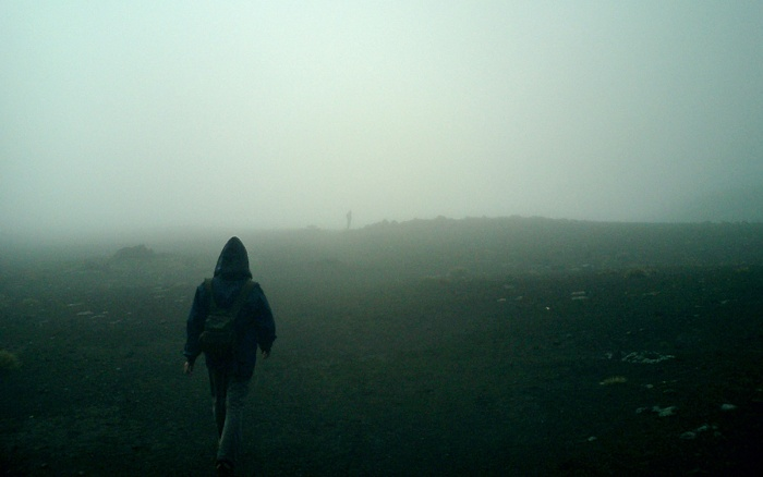 Tongariro Crossing - New Zealand - walking through clouds in South Crater