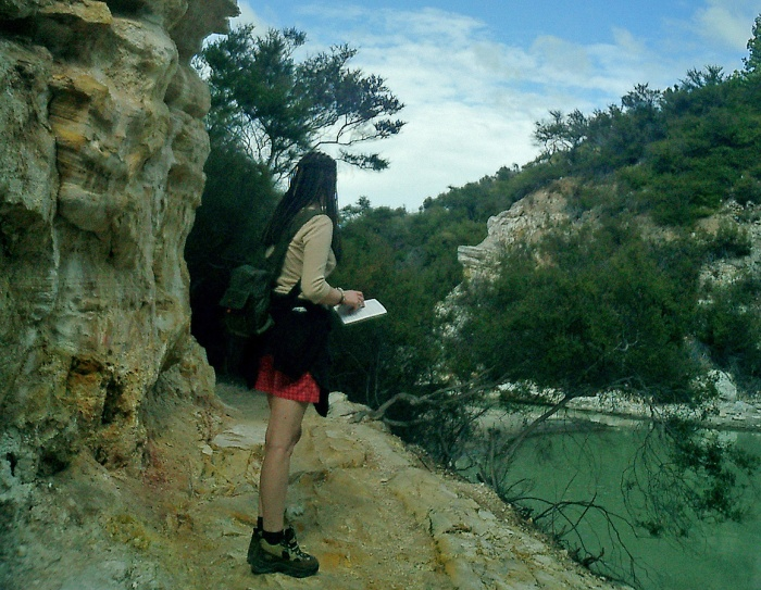 Wai-O-Tapu New Zealand girl in short skirt and hiking boots