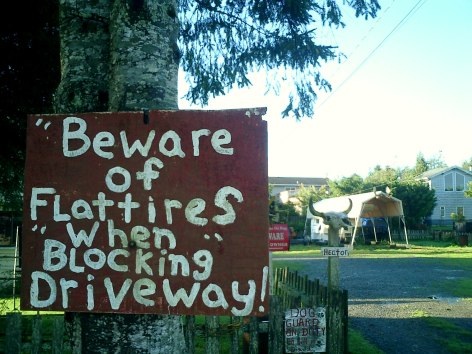Travel Photo Canada 2003 by David J Rodger Tofino Vancouver Island funny no parking sign - Beware of Flat tires when blocking driveway