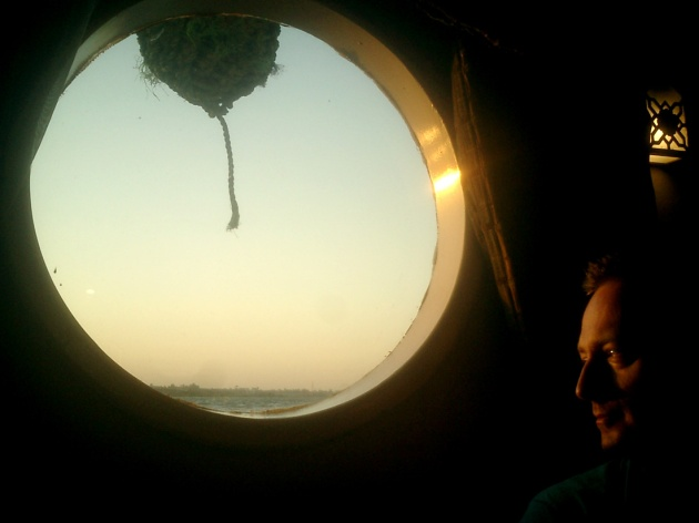 Travel Photo Egypt Nile Cruise Photos by David J Rodger - Gazing out porthole onto the River Nile