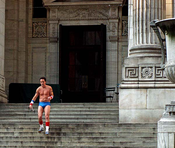 New York - travel photo - semi naked man running down steps of New York Public Library