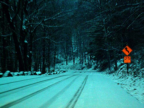 New York - travel photo - tyre tracks in the snow - remote mountain road