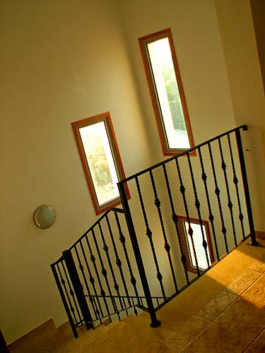 Travel photo Cyprus remote villa on edge of mountains staircase wrought iron