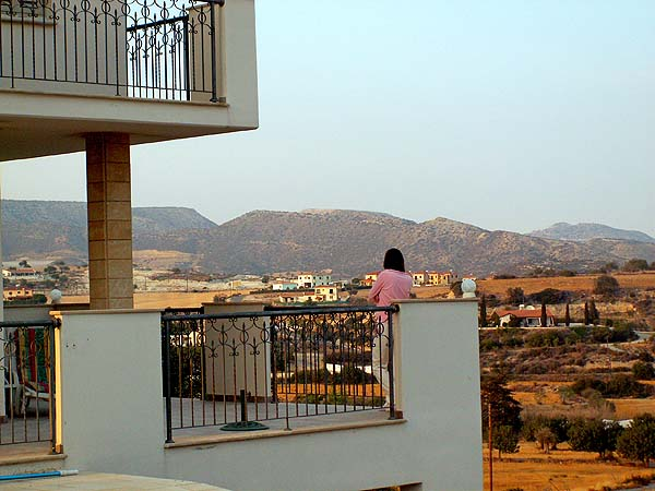 Travel photo Cyprus remote villa on edge of mountains view of double balcony