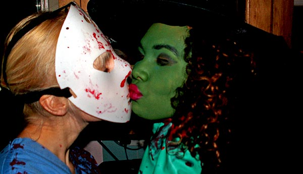 Halloween Party Bristol UK girl in psycho mask kisses girl dressed as a witch