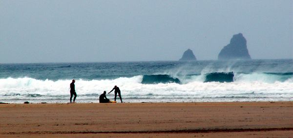 Cornwall England - travel photo - surfers on a beach