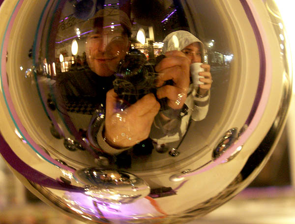 travel-photo-man-and-woman-distorted-reflection-in-christmas-bauble-bruges