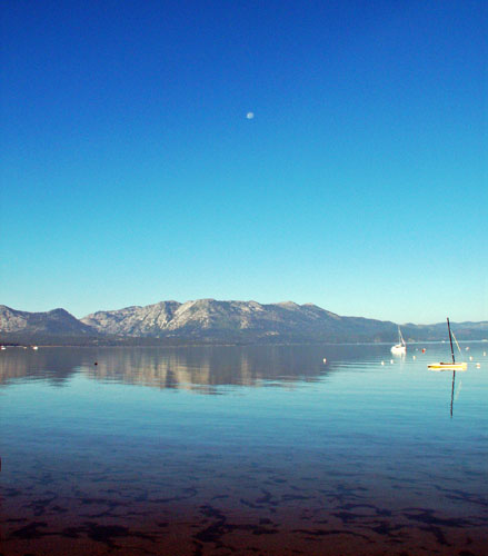 south-lake-tahoe-early-morning-sitting-on-the-beach-with-a-full-moon-still-in-the-sky