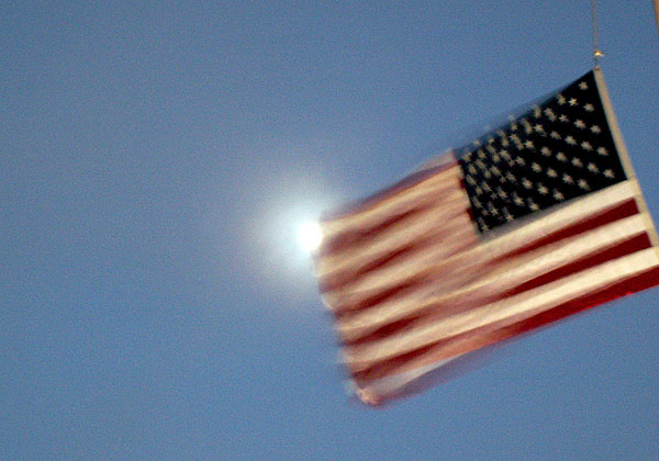 usa-flag-against-a-full-moon