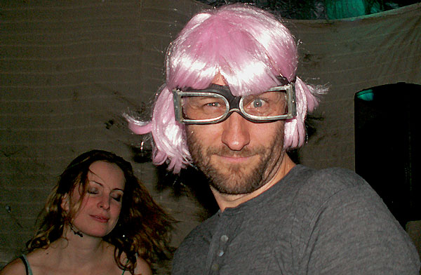Photo of Dan D getting into the pink wig groove at a Hot Tub Time Machine party