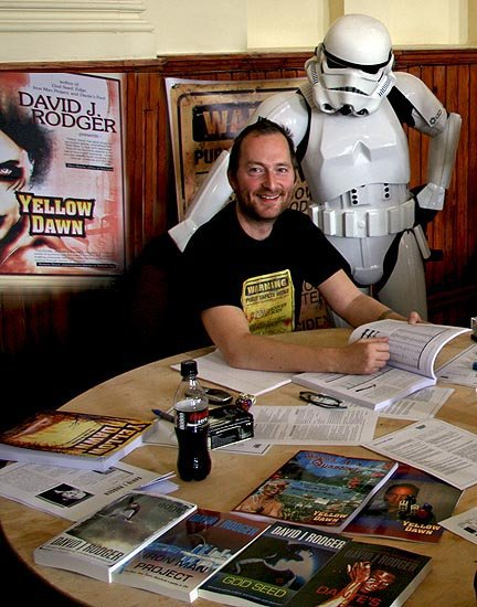 Photo of David J Rodger science fiction and dark fantasy author with his books - RPG Game Yellow Dawn - and a stormtrooper