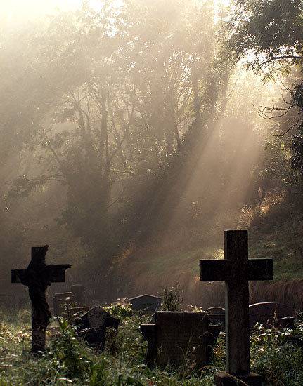 Arnos Vale Cemetery Bristol UK - grave headstones and tree-dappled sunlight - ghostly images