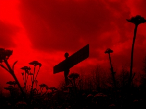 Angel of the North in a blood red sky photo by David J Rodger