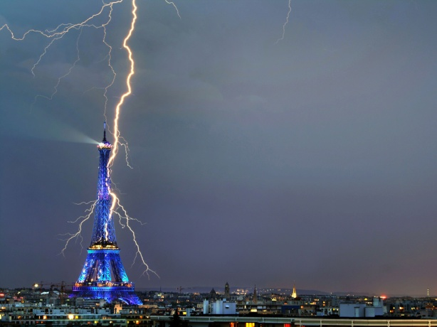 Awesome photograph lightning bolt appearing to strike the Eiffel Tower image by Bertrand Kulik all rights reserved