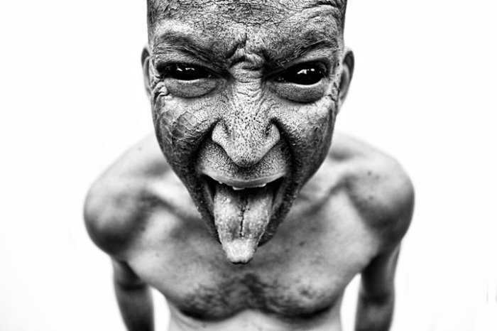 Evil Mockery - photograph of demon in human form - Dart Art by Danielle Tunstall