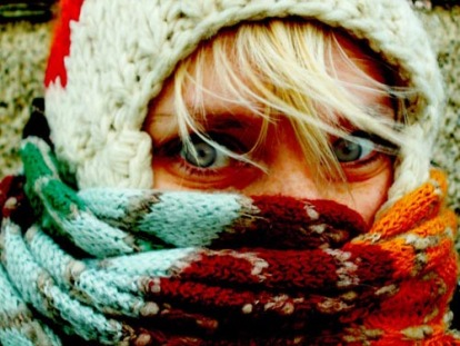 girl-with-green-eyes-and-scarf-wrapped-around-face