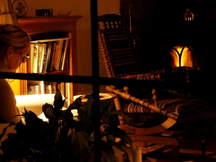 Kosekroken photo of cosy house woman reading with rocking chair and fire by David J Rodger