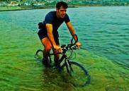 man-cycles-through-sea-towards-st-michaels-mount
