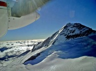 Mount Aspiring Tititea New Zealand South Island - twin prop plane fly by