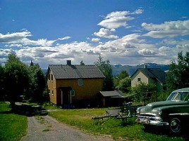 simple wooden house and classic car in Fauske arctic circle Norway