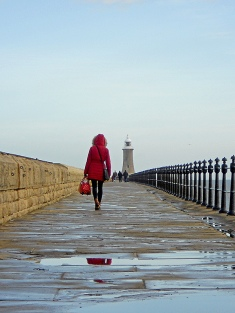 tynemouth-pier-north-east-england-girl-in-red-walks-along-after-winter-rain