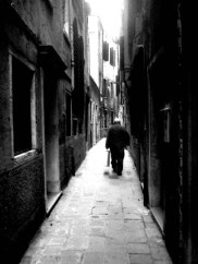 Venice - solitary man in a medieval lane like a labyrinth