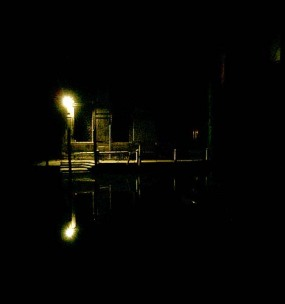 Venice water way at night - canal like black silk - scene of horror