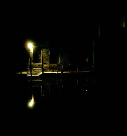 Venice water way at night - canal like black silk - scene of horror