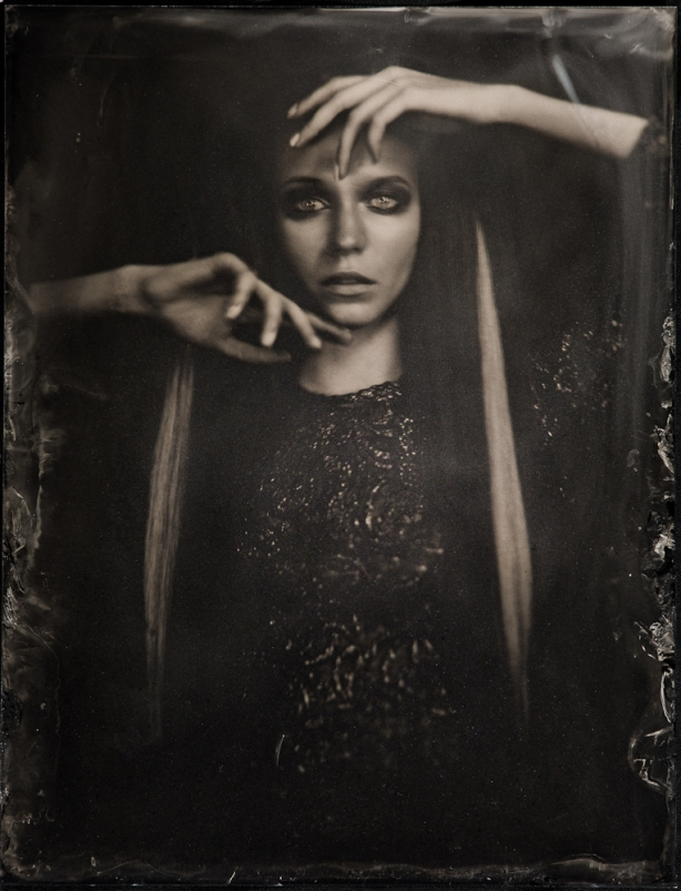 woman photographed using traditional analogue techniques - dark tonality - artefacts from drying emulsion - silver and cynadide - image copyright Igor Vasiliadis all rights reserved