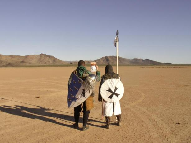 When the future imitates the past - two knights on Crusader Walk in Arizona USA - Dog Eat Dog steps into context
