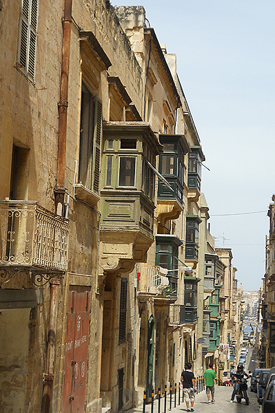 Malta Valletta - typical architecture is limestone structure with enclosed wooden balcony
