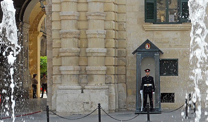 Malta Valletta soldier on guard outside prime minster and parliament building