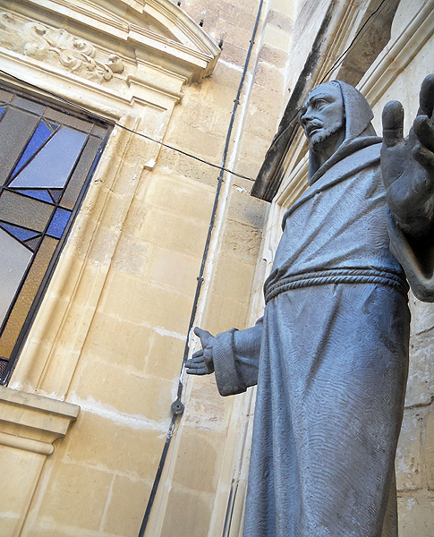 mdina rabat statue of religious figure monk standing with hands apart