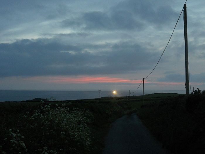Strumble Head lighthouse Pembrokeshire Wales at sunset