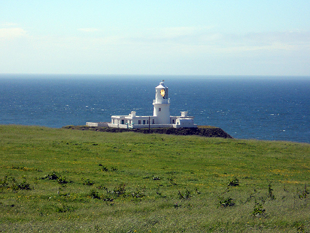 Strumble Head Lighthouse overlooking remote cottage where David J Rodger wrote The Black Lake