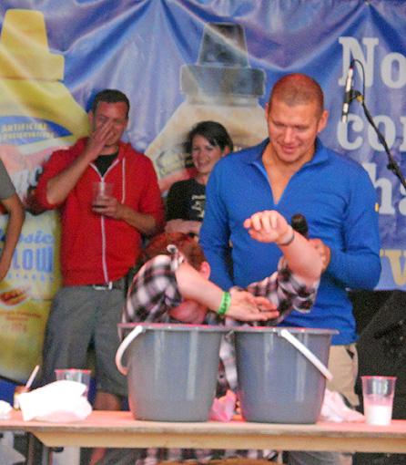 Grill Fest - July 2012 - Bristol UK - BBQ pork ribs and chilli eating contest - hero crumples hero folds hero dies