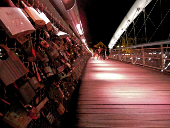 padlocks of love on Wisla bridge Krakow Poland