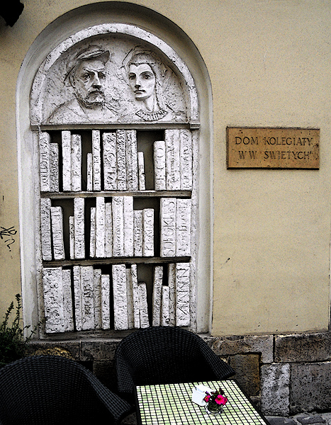 Carving of a bookshelf outside cafe in Krakow Poland