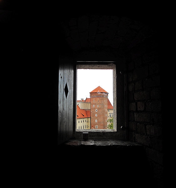 view of Wawel Castle tower from a fortress tower window