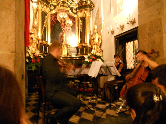 Krakow Poland Royal Chamber Orchestra performing a medley of classical peices inside 11th century Church of St Adalbert