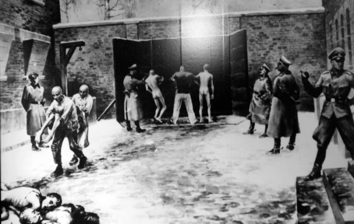 Auschwitz Poland black and white artwork depicting execution of prisoners at Death Wall