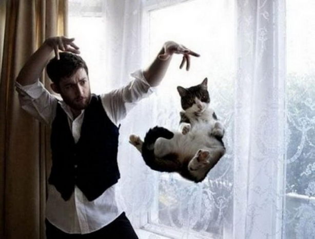Mysterious man magician levitates cat