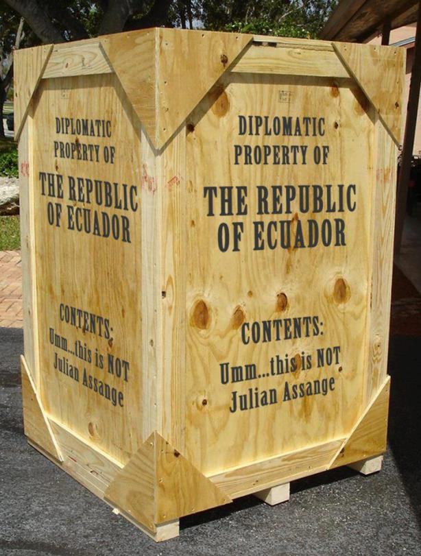 Schrodinger's Assange Photo of wooden crate The Diplomatic Property of the Republic of Ecuador
