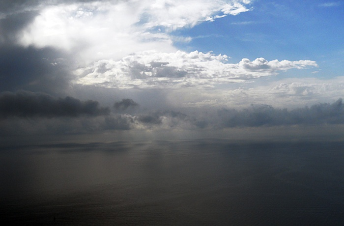 Travel photo Sicily clouds hovering over the Ionian Sea by David J Rodger
