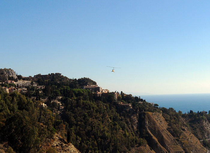Travel photo Sicily  gyrocopter very James Bond hovers over Taormina by David J Rodger