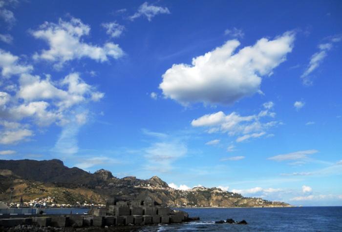 Travel photo Sicily looking up at Taormina and Castlemola from Giardini Naxos by David J Rodger